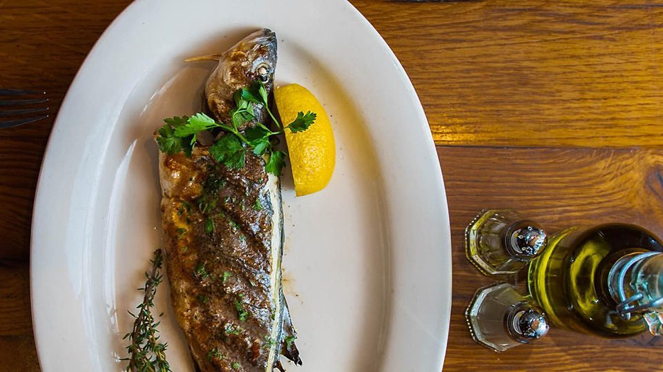 Whole Bronzino Fish with lemon and herbs